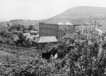 Back of Emersons mill with hills